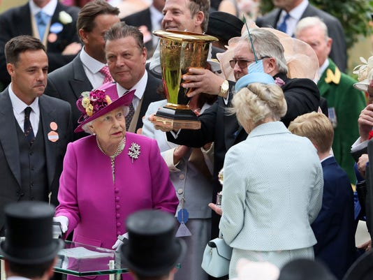 Queen Elizabeth II presents the trophy for the Diamond Jubilee Stakes during day five of Royal Ascot at Ascot Racecourse. Saturday June 24, 2017.  (Brian Lawless/PA via AP)