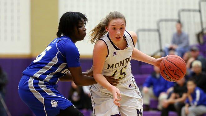 Monroe's Erin Seppi drives on Sayreville defender Morenike Akinrefon during the second quarter, Thursday, January 28, 2016, in Monroe Twp.