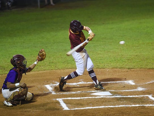 Father Duenas Friars player Cooper Paulino swings at
