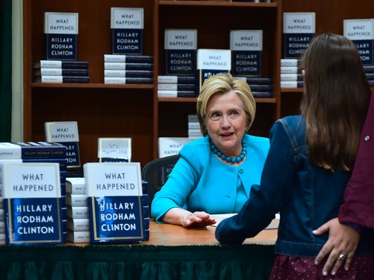 Hillary Clinton greets a supporter getting a signed