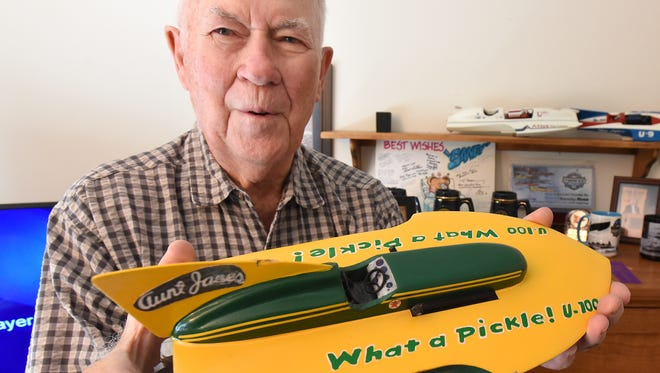 South Lyon resident Sandy Ross once piloted an Unlimited class hydroplane boat like the model he's holding in 1958 on the Detroit River. Unfortunately, Ross, 88, couldn't get the boat to the required 90 mph average speed for the course.