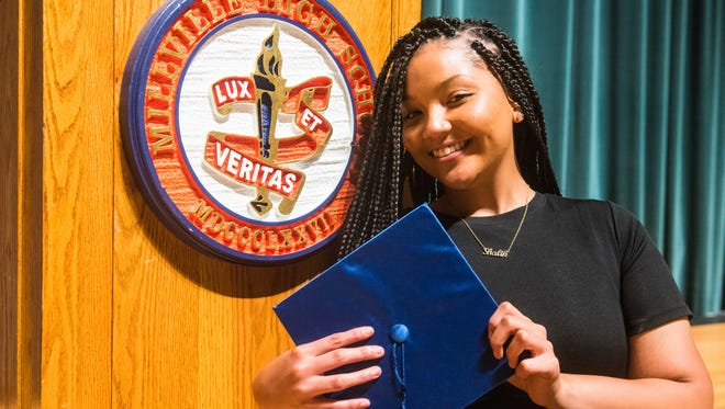 Millville Senior High School senior Sandra Lee Cruz, a National Honor Society member, graduates on Thursday.