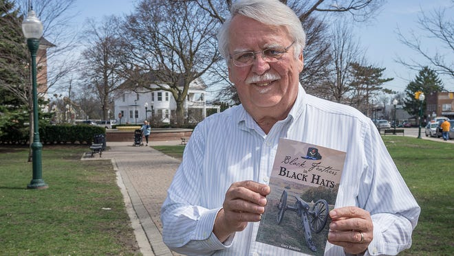 """Gary Rembisz is the author of """"Black Feathers in Black Hats,"""" a story of the Union Army's 24th Michigan Infantry. He is photographed in Plymouth's Kellogg Park, where men were recruited to fight in the Civil War."""