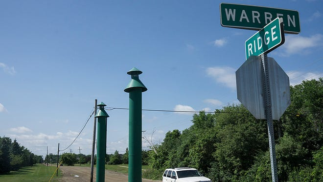 A township board majority has opted not to move ahead with a project to pave a portion of Ridge Road on Canton's west side.