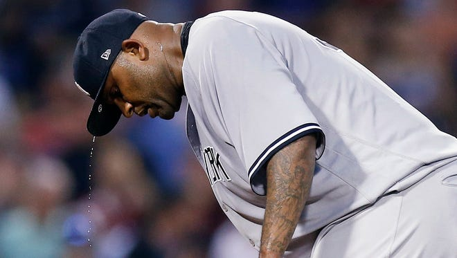 New York Yankees' CC Sabathia pauses after walking in a run during the second inning of the team's baseball game against the Boston Red Sox in Boston, Thursday, Aug. 2, 2018.