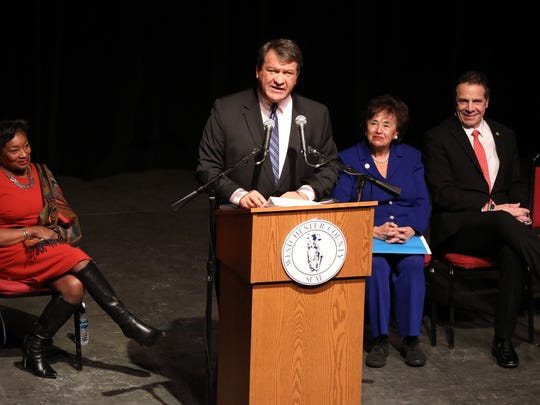 Westchester County Executive George Latimer delivers remarks during his inauguration at Westchester Community College in Valhalla, Jan. 7, 2018. Behind him are State Senator Andrea Stewart-Cousins, U.S. Rep. Nita Lowey and New York Governor Andrew Cuomo.