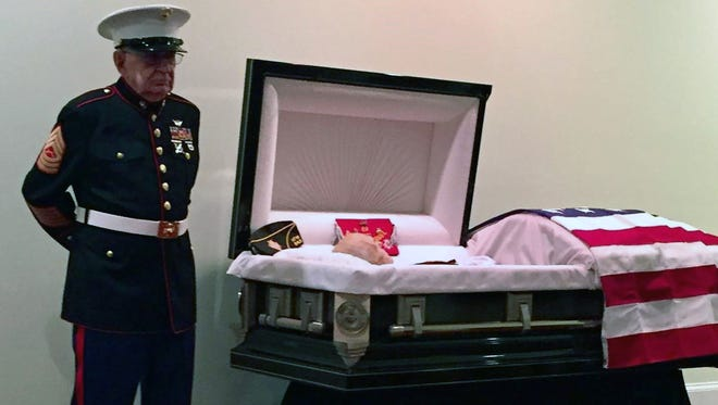 Retired Marine Master Sgt. William Cox stands guard Oct. 24, 2017, at the casket of his friend, James Hollingsworth, in Augusta, Ga.