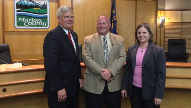Left to right: Marion County Commissioners Kevin Cameron, Sam Brentano and Janet Carlson.