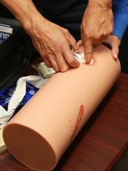 "A ""Stop the Bleed"" program training session participant"