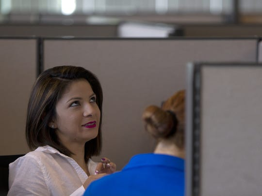 Gracy Lopez, left, interviews with team leader E. J. Mina at Alta Resources in Fort Myers Friday, August 15.