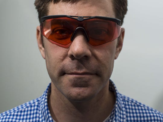 Brendan Gallivan, who manages product development at Revision in Essex, wears Lazrbloc, ballistic eyewear that blocks 99.9% of green light lasers and 99% of infrared light on Tuesday, February 16, 2016.