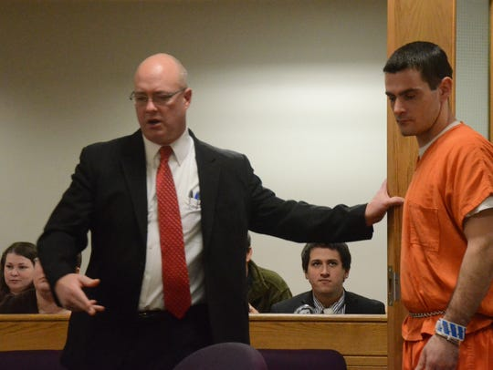 Defense attorney Brandon Hultink holds the door for