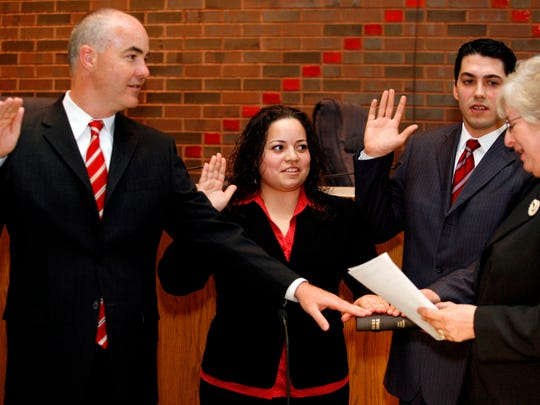 Angelina Tirado sworn in as a new firefighter along with John Bradley and Patrick Cassidy on June 8, 2010.