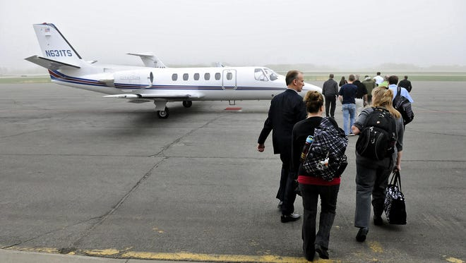Coborn's employees board a plane bound for Williston, N.D. on May 6, 2015, at St. Cloud Regional Airport.