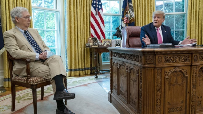 Senate Majority Leader Mitch McConnell of Ky., listens as President Donald Trump speaks during a meeting in the Oval Office of the White House, Monday, July 20, 2020, in Washington.