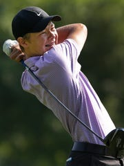 Sam Galloway of Neenah hits a tee shot during the Post-Crescent/Fox Cities Amateur adult golf tournament July 18, 2014 at Reid Golf Course in Appleton.