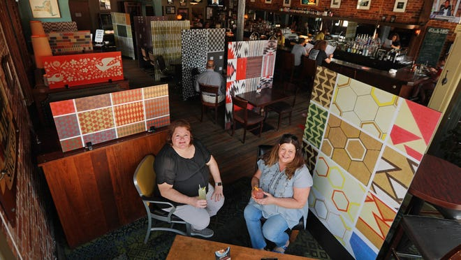 Key Blue Print owner Cheryl Frizzell, left, and Club 185 owner Tina Corbin collaborated to use designer Alexander Girard's designs as COVID-19 table dividers at the popular German Village bar and restaurant. The two businesses are neighbors across Mohawk Street on East Livingston Avenue.