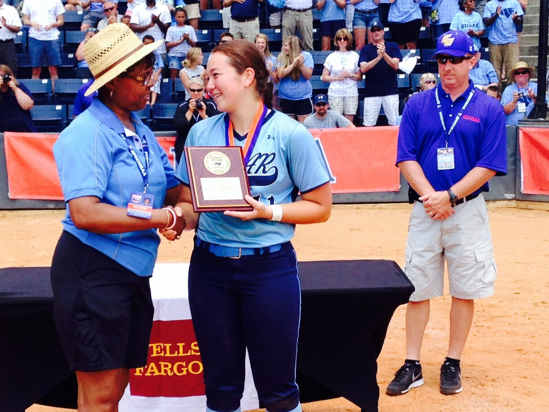 Enka catcher Jordan Harris, pictured here with NCHSAA commissioner Que Tucker, is the Citizen-Times All-WNC Softball Player of the Year.
