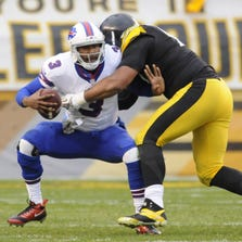 EJ Manuel tackled by a Pittsburgh defender in the 2013 game at Pittsburgh.