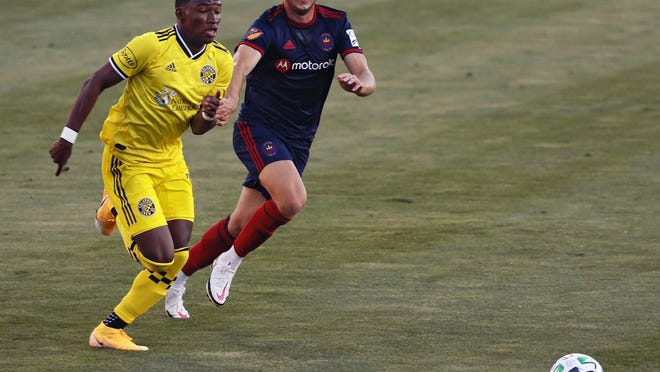 The Crew's Luis Diaz, trying to beat the Fire's Djordje Mihailovic to the ball on Aug. 20, has one assist and no goals in seven games this season.