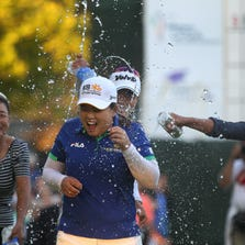 Inbee Park is doused with water and beer after her defeating Brittnay Lincicome on the first hole of a sudden-death playoff at the Wegmans LPGA Championship Sunday at Monroe Golf Club.