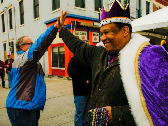 Mardi Gras King Dr. O'dell Owens gives a high five
