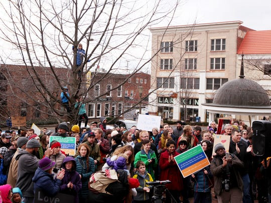 Over 500 people attended the United We Stand With Immigrants and Refugees rally at noon on Court Square in Harrisonburg on Sunday, Jan. 29, 2017 holding signs and marching around downtown Harrisonburg.