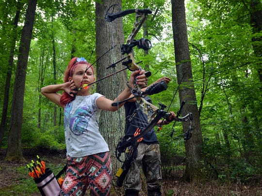 Cheyenne Fetrow, 12, of York, takes aim at a target while she and her dad, Matthew, prepare for the upcoming archer season by taking part in a 3-D archery shoot at York Archers in Lower Windsor Township, Sunday, Aug. 8, 2017. Cheyenne has been shooting archery for two years, and this will be her first year hunting. John A. Pavoncello photo