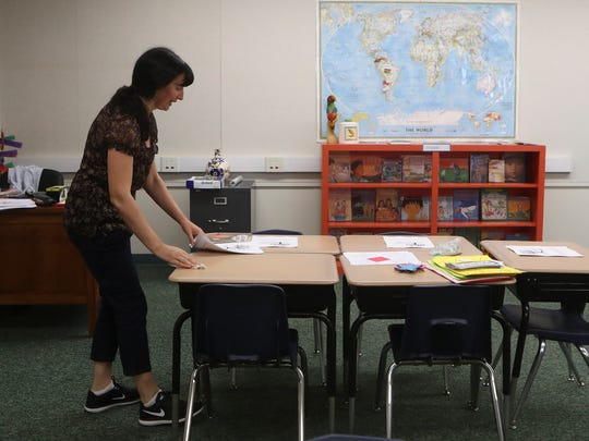 Third and fourth grade teacher Cecilia Henson gets her classroom ready Thursday at the Tree of Life International Charter School in Anderson. The new school is set to open Monday.