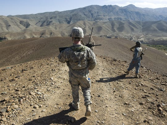 2010 -- Vermont National Guard 2nd Lt. Parker Chapman heads into lower Dandar village in Afghanistan to talk with residents there and get a sense of whether the area is friendly or not.