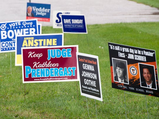 Signs for school board members and judges were displayed at the entrance of the Manchester Township building on Tuesday.