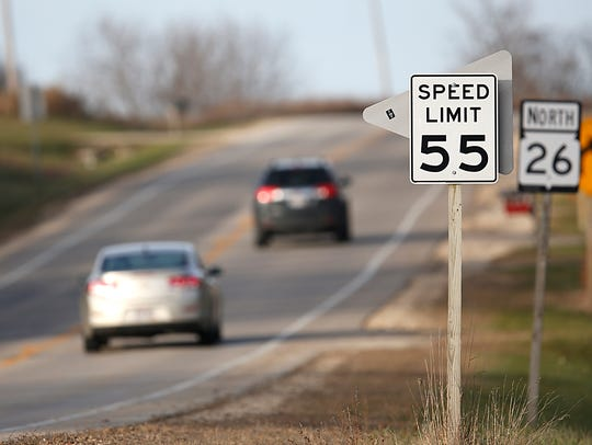 Two cars travel along State 26 Monday, Nov. 20, in