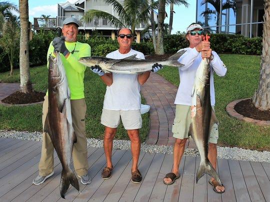 Marco Island residents Jim Doench, left, John DeRossi,