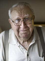 Lester Menke, 96, stands for a portrait at his home