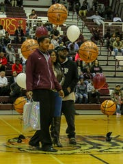 PHS' Davonchae Bryant, left, is recognized during Senior Night before the game against Pine Forest at Pensacola High School on Friday, January 19, 2018.