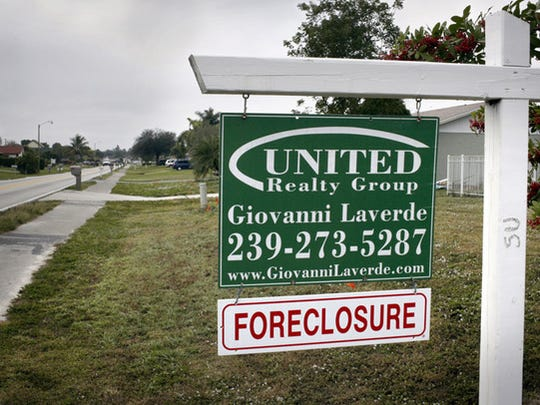 FILE - A home in Golden Gate City sits empty as a foreclosure sign hangs outside of it on Tuesday, Dec. 30, 2008.