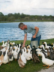 Shane Sieg feeds some of his ducks. Asbury Acres is