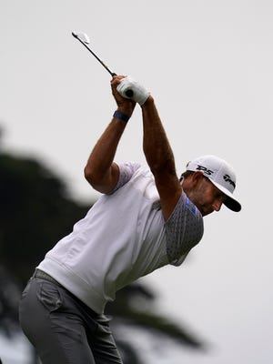 Dustin Johnson hits his tee shot on the second hole during the third round of the PGA Championship golf tournament at TPC Harding Park Saturday, Aug. 8, 2020, in San Francisco.