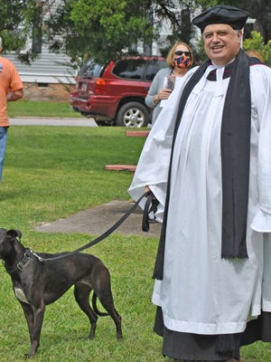 Rev. Drew Collins with his rescue dog Bee.