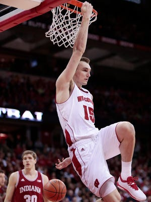 Wisconsin Badgers forward Sam Dekker (15) hangs on the rim after getting fouled on a made dunk in the second half of a game against the Indiana Hoosiers at the Kohl Center in Madison, Wis., Tuesday, Feb. 3, 2015.  M.P. KING -- State Journal