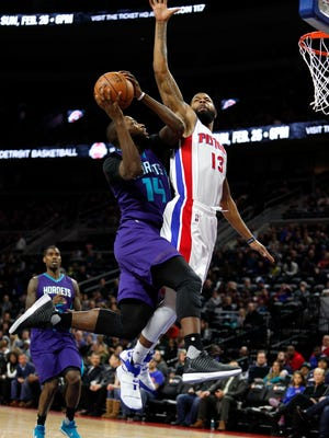 Jan 5, 2017; Auburn Hills, MI, USA; Hornets forward Michael Kidd-Gilchrist attempts a shot against Pistons forward Marcus Morris during the second quarter at the Palace.