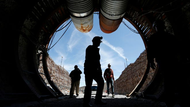 People walk into the south portal of Yucca Mountain during a 2015 congressional tour of the proposed radioactive waste dump near Mercury, Nev., 90 miles northwest of Las Vegas.