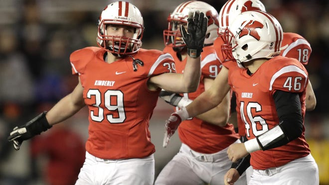Kimberly's Tyler Staerkel (39) celebrates with teammates after getting an interception against Franklin during the WIAA Division 1 state championship game Friday in Madison.