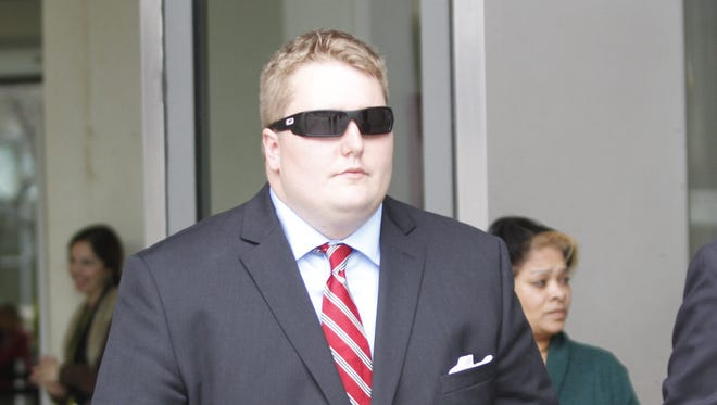 Eric Gaulin, 25, leaves the Westchester County Courthouse after being arraigned for the shooting death of Megan Bookstaver, 23.  April 15, 2014.