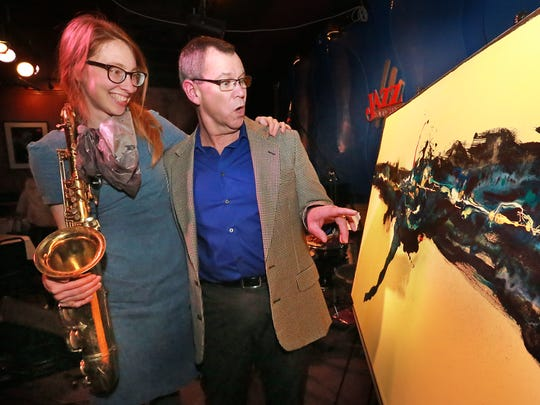Jazz sax musician Sophie Faught and Steven Sickles, a local abstract painter who inspired her new album.