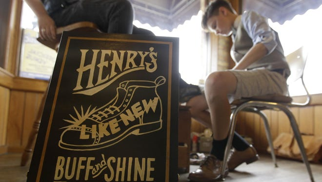 Henry Ptacek launched his Henry's Buff and Shine business last year after his grandfather gave him his old shoeshine kit and taught him the skills. Henry is a freshman at Appleton North High School.