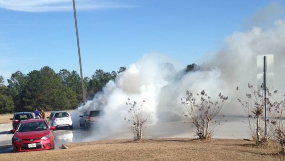 The scene of a mid-afternoon car fire Monday at Pine Belt Regional Airport.