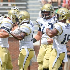 Aug 30, 2014; Atlanta, GA, USA; Georgia Tech Yellow Jackets running back Zach Laskey (left) celebrates with teammates after scoring a touchdown against the Wofford Terriers during the first quarter at Bobby Dodd Stadium. Mandatory Credit: Kevin Liles-USA TODAY Sports