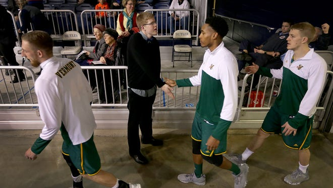 Former Columbus North basketball standout Josh Speidel greets  his Vermont Catamounts teammates before the start of their game against the Butler Bulldogs Wednesday, December 21, 2016, evening at Hinkle Fieldhouse.