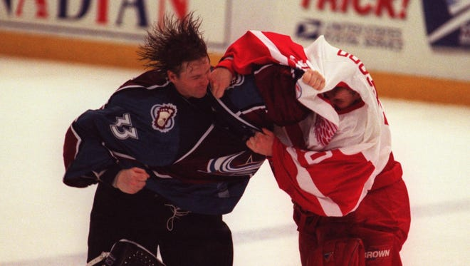 The rivalry had everything, including goalie fights between the Avs' Patrick Roy and the Wings' Mike Vernon and later Chris Osgood (above).